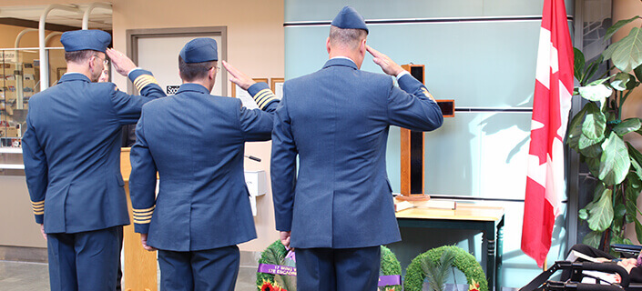 Veterans saluting a cross at Deer lodge Centre